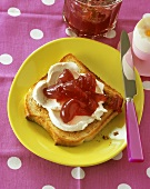 Slice of toast with soft cheese & blackberry & grapefruit jelly