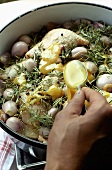 Making duck confit with shallots: marinating in honey