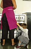 Mother son at stove in kitchen