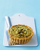 Onion, pea and Pecorino tartlet with mint