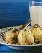 Herb dumplings with walnuts