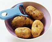 Potatoes with peeler