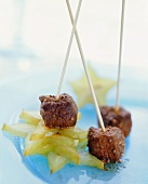 Spicy beef skewers on carambola