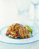 Veal escalopes with curry and lime and tropical salsa