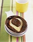 Pear baked in chocolate mousse