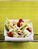 Salad of prawns, avocado, feta, hearts of palm and tomatoes