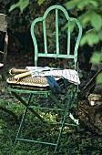 Garden chair with garden tools