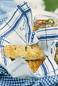 Spinach pasties on blue and white tea towel