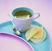 Tea with slice of lemon and Parmesan crisps