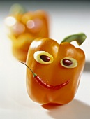 Orange pepper with face