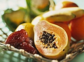 Basket of fruit: papaya, dates etc.