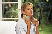 Woman with quark compress round her neck