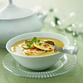Creamy soup with potato pancakes