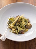 Green ribbon pasta with calf's liver and pear ragout