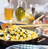 Ingredients for courgette risotto in a frying pan