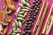 Mace, cardamom pods, allspice berries and cinnamon sticks