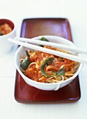 Ribbon noodles with tomato sauce and basil