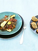 Shoulder of lamb with courgettes, tomatoes and aubergine caviar