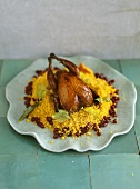 Partridge on couscous with pomegranate seeds