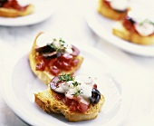 Tomatoes, olives and cheese on toast