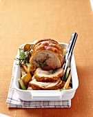 Stuffed loin of pork with roasted vegetables