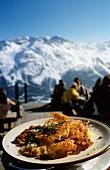 Potato rösti (fried potato cakes) served outside a mountain hut