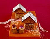 Chocolate cake houses and truffle praline figures