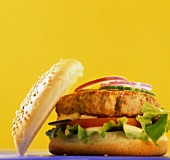 Hamburger in front of a yellow background