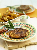 Grilled pork steak with guacamole and potatoes