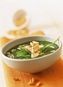 Spinach soup with blue cheese and pine nuts