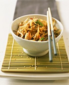 Hot and spicy glass noodles with chicken, beansprouts and sesame