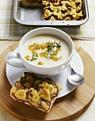 French potato soup with onions and a slice of damson cake