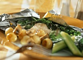 Herb trout steamed in foil with mushrooms and potatoes