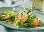 Potato roulade filled with vegetables and ham