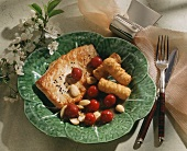 Pork escalope with cherries, almonds and potato croquettes
