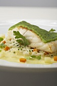 Brill fillet with a parsley crust on creamy vegetables