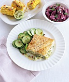 A courgette and feta pie with a cucumber salad