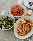 Brussels sprouts with pancetta, roast potatoes and parsnips and caramelised carrots