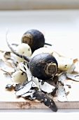 Black winter radishes on a chopping board