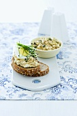 A slice of bread spread with egg salad