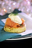 A blini with smoked salmon and sour cream