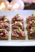 Canapes with duck and onion chutney