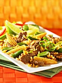 Red beef curry with corn cobs and rice (Asia)