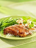 Tandoori haddock with mange tout and rice