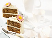 Two slices of banana and pineapple cake decorated with sugar flowers