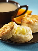 Buttermilk biscuits with butter and a cup of tea