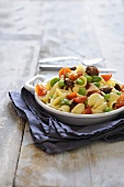 Orecchiette pasta with beans, meat dumplings and tomatoes