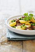 Lamb tagine with preserved lemons, potatoes and peas