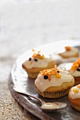 Cupcakes with a cream cheese glaze and carrots