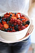 A red berry salad with star anise